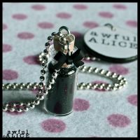 AWFUL ALICE 'Do Not Drink' Necklace in Black by wickedland