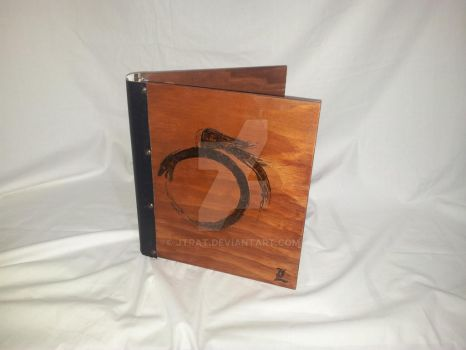 Ouroboros wooden folder by jtrat