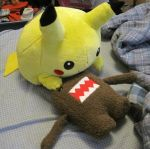 Pikachu eats Domo by secretsheik