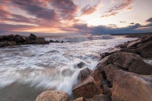 Pastel Tones, Slight Sea and Brown Rocks by jimitux