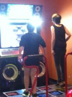 Getting our DDR on! by DarkendDrummer