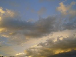 Beautiful golden and silver clouds in blue skies by mylesterlucky7