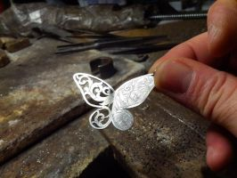 Silver butterfly engraved by Debals
