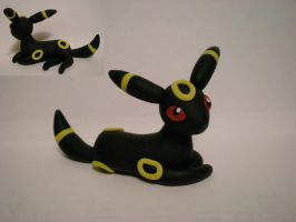 Laying Umbreon by Foureyedalien