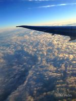 Winging Above the Clouds by JMPorter