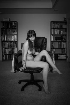 Layla Angelle sitting in a chair by Frisson-Art