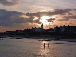 the sun sets on Southwold lighthouse by peevee01