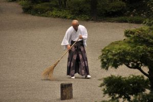 Monk Sweeping Gravel by AndySerrano