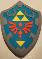 Zelda Hylian Shield cake by whisk-us-away
