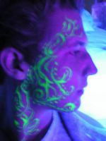 blacklight facial tattoo art by fog0