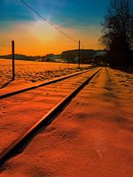 Winter season railroad sunset by patrickjobst