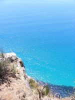 Rocks And Clear Blue Water by Gracies-Stock