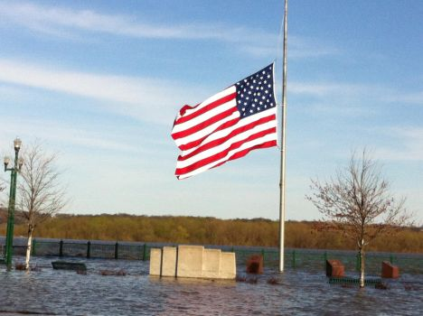 Nations Flag In the midst of a flood by MissCuriousZ