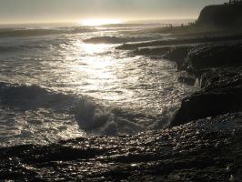 Santa Cruz rocky shore at sunset by findmeaname