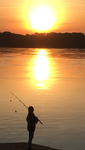 Young fisherman at dawn  by dragonturtle