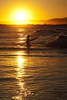 Surfer at sunset by wildplaces
