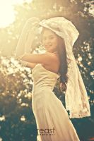 ...the bride exposed to the sun's... by reastphoto