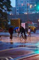 cycling in the rain by inkoginko