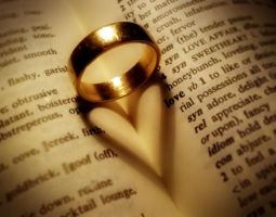 Ring on Book w heart shadow by JonEastwood
