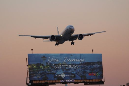 Boeing 777-300ER with a billboard by AnthonyC12
