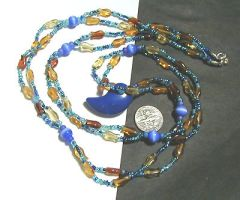Magatama necklace with fishies by wombat1138