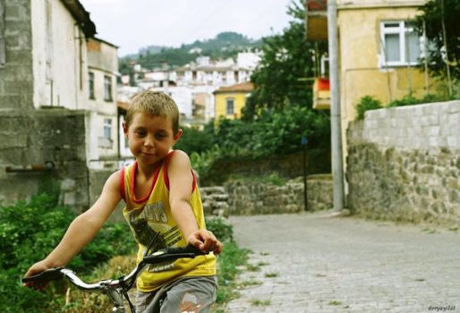 child with bicycle by deryayilal