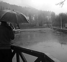Standing in the rain by Aderock