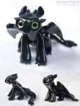 Seated Toothless Sculpture by HowManyDragons