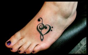 Music foot tattoo by melancholy-spiders